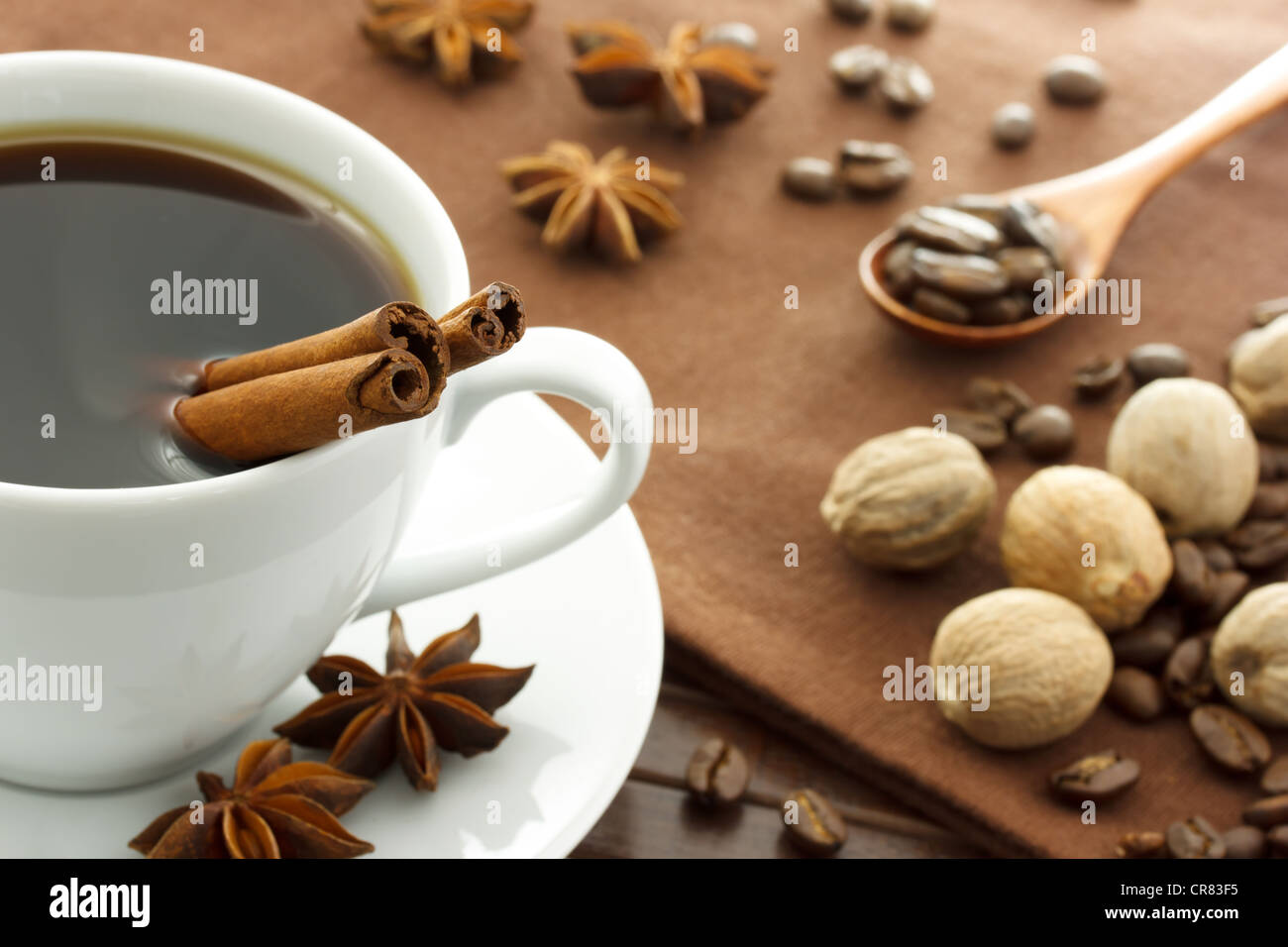 Hot Cup of Coffee with Spices - Cinnamon Star Anise and Nutmeg - Stock Image