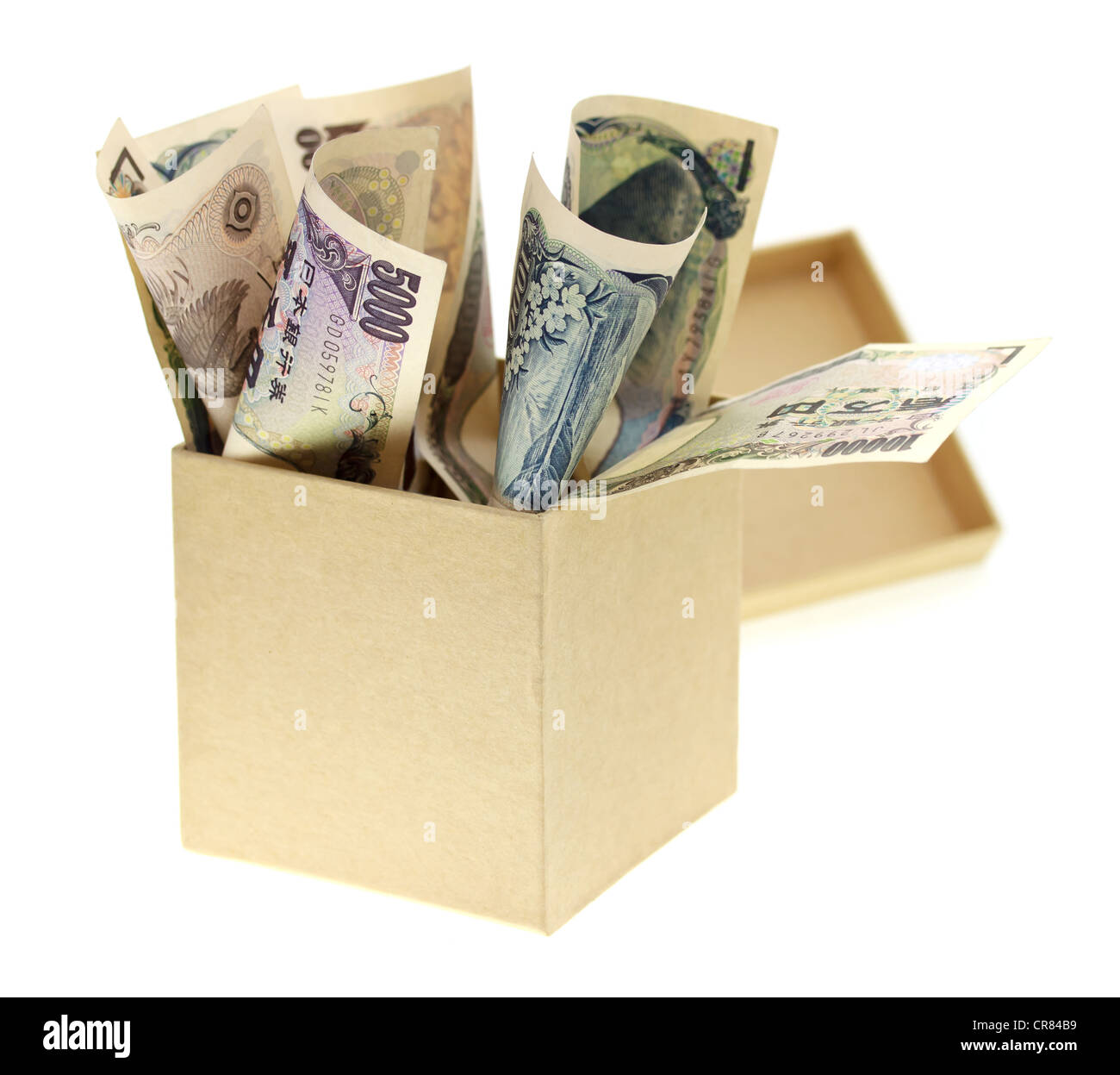 Box Overflowing with Japanese Yen - Stock Image