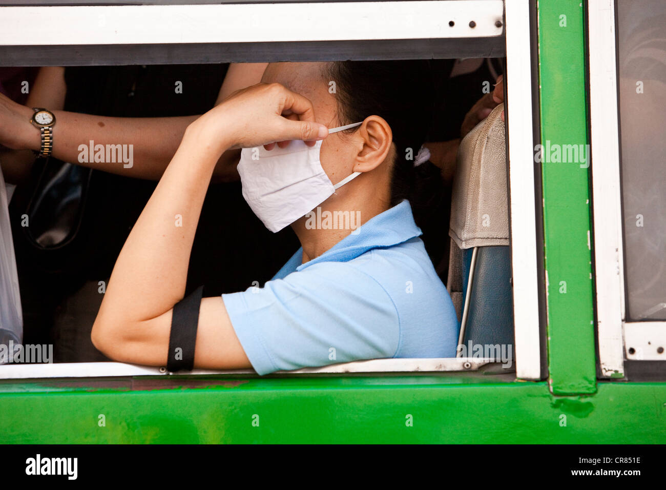 Thailand, Bangkok, passenger bus with a protective mask against pollution - Stock Image