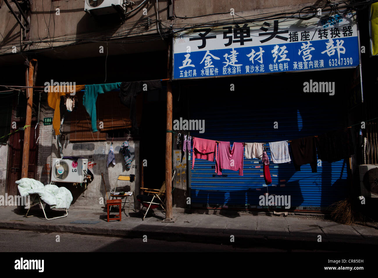 Laundry shop stock photos laundry shop stock images alamy laundry hanging outside of shop in streets of shanghai china stock image solutioingenieria Images