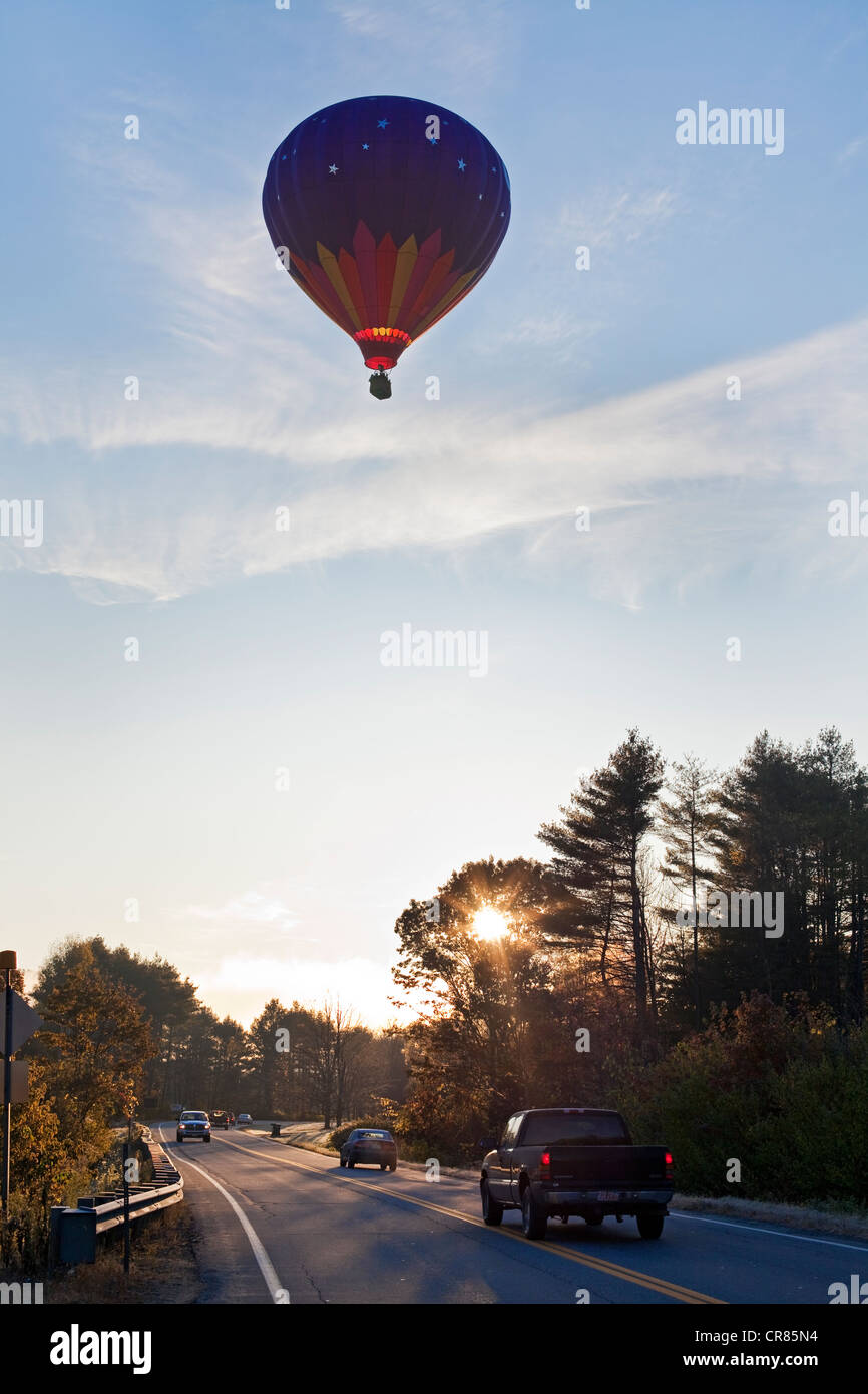 United States, New England, Vermont, hot-air balloon flying in the morning on the road between Hartford and Woodstock - Stock Image