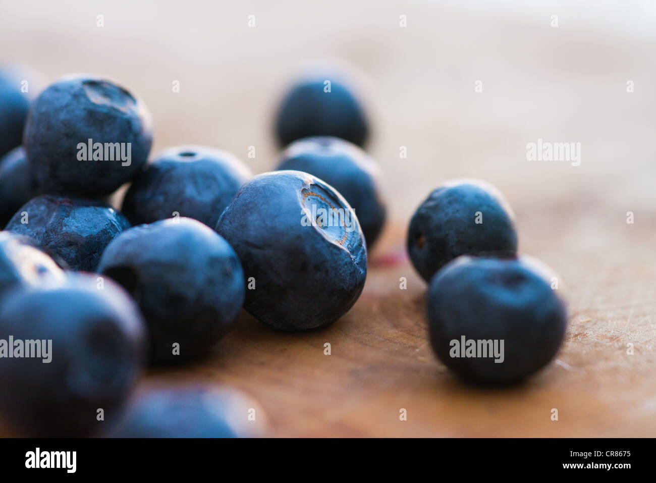 Blueberries on a wooden board - Stock Image