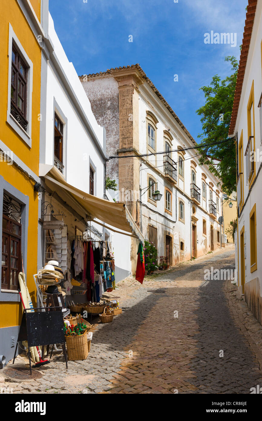 Local shop on a narrow cobbled street leading up to the Castle in the Old Town, Silves, Algarve, Portugal - Stock Image