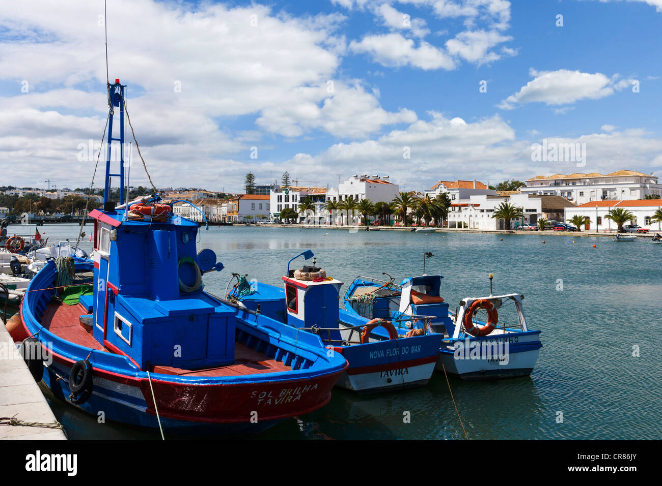 Fishing boats moored on the River Gilao in the Old Town, Tavira, Algarve, Portugal - Stock Image