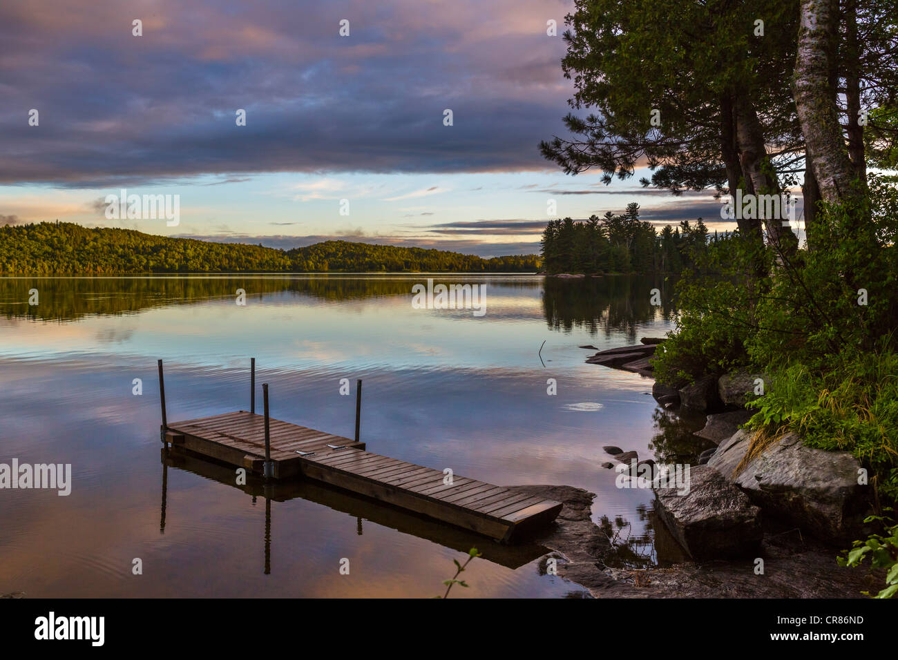 Lakefront at sunset at the Killarney Lodge resort, Lake of Two Rivers, Algonquin Park, Ontario, Canada - Stock Image