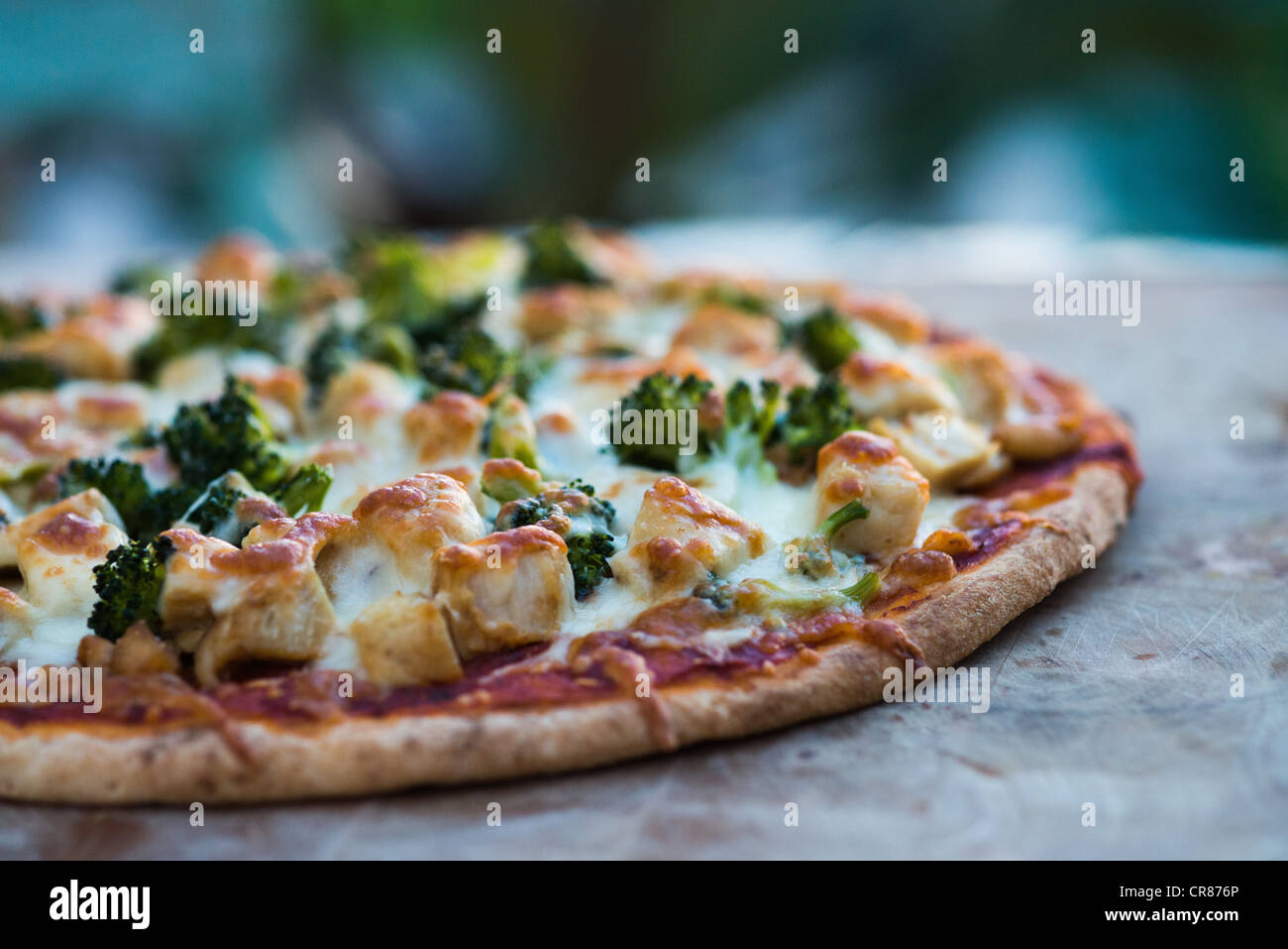 Pizza on a wooden board - Stock Image