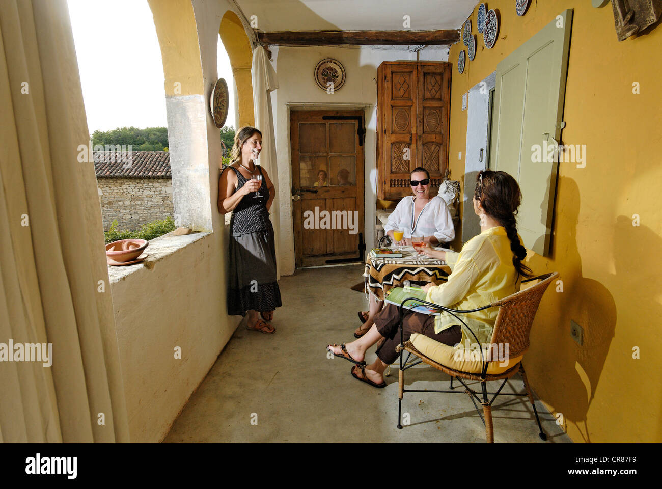 France, Gard, Barjac, early evening drink with friends at Mas Escombelle - Stock Image