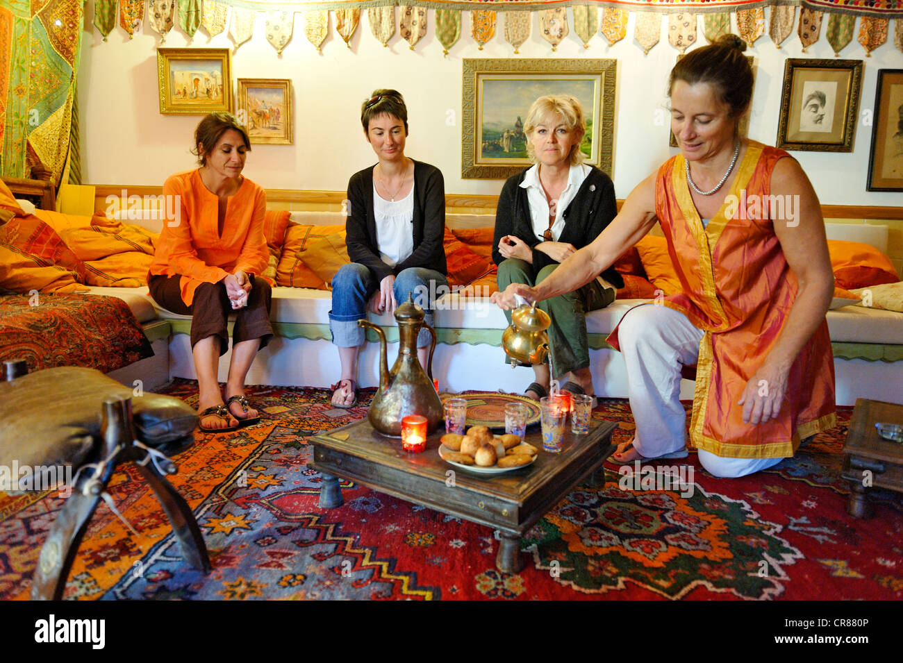 France, Gard, Barjac, Mas Escombelle, tasting homemade pastries accompanied by tea after the massage - Stock Image