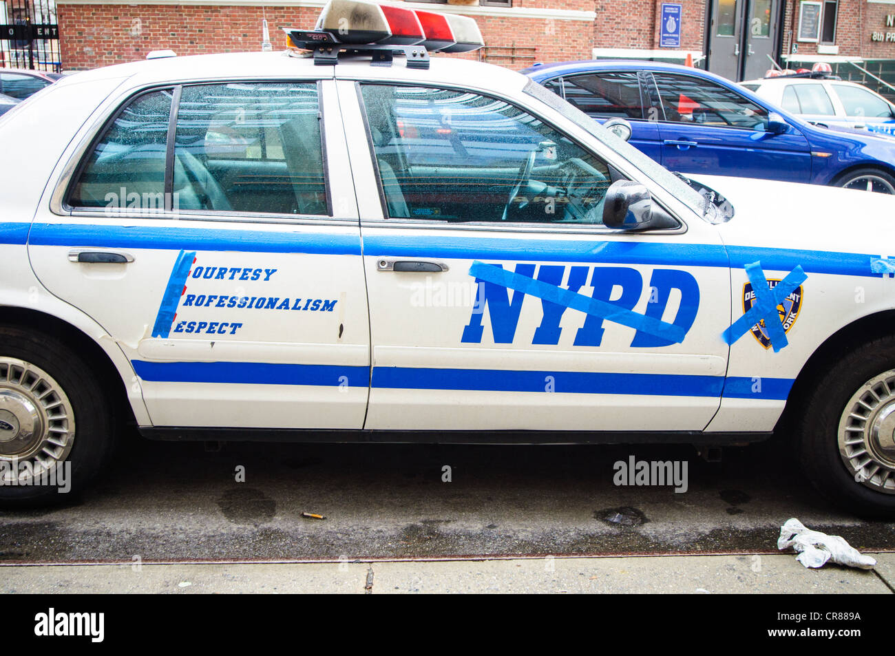New York City Police Department cars with NYPD words and graphics taped over, at a TV taping in New York City. - Stock Image