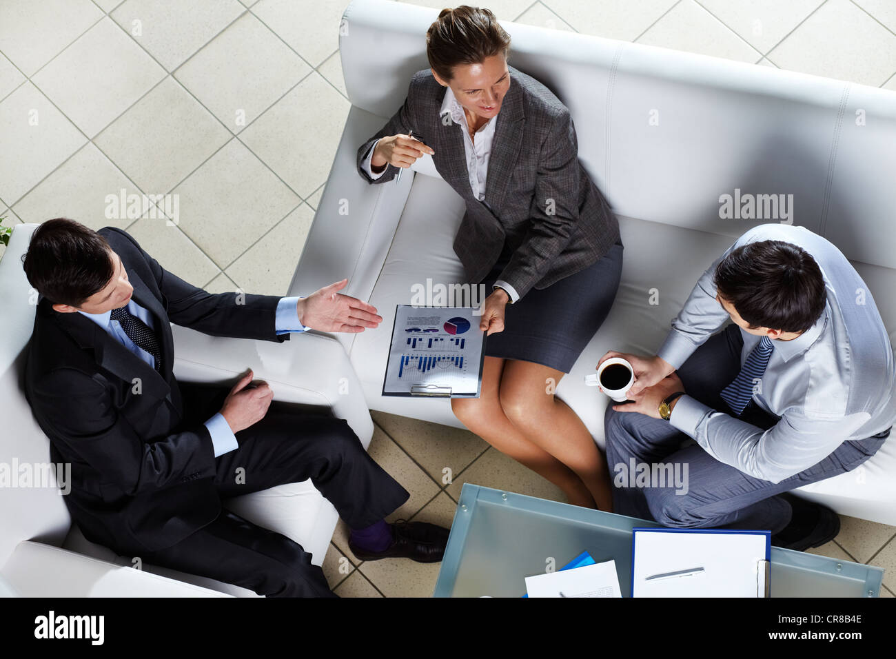Overview of business team discussing some graphs and diagrams - Stock Image