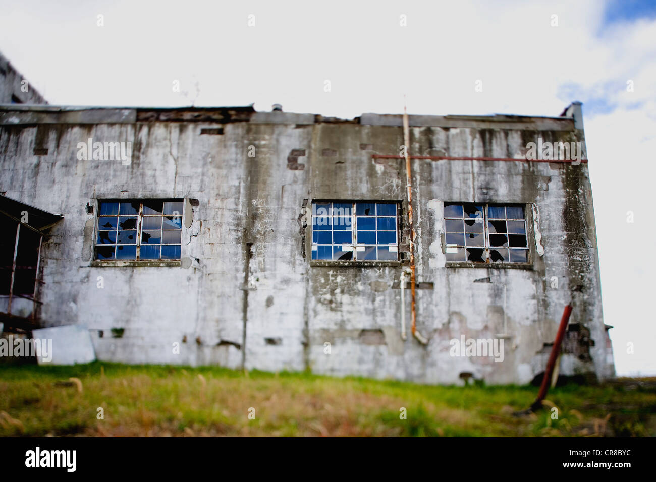 Run down processing plant shot shortly before demolition, tilt shift - Stock Image