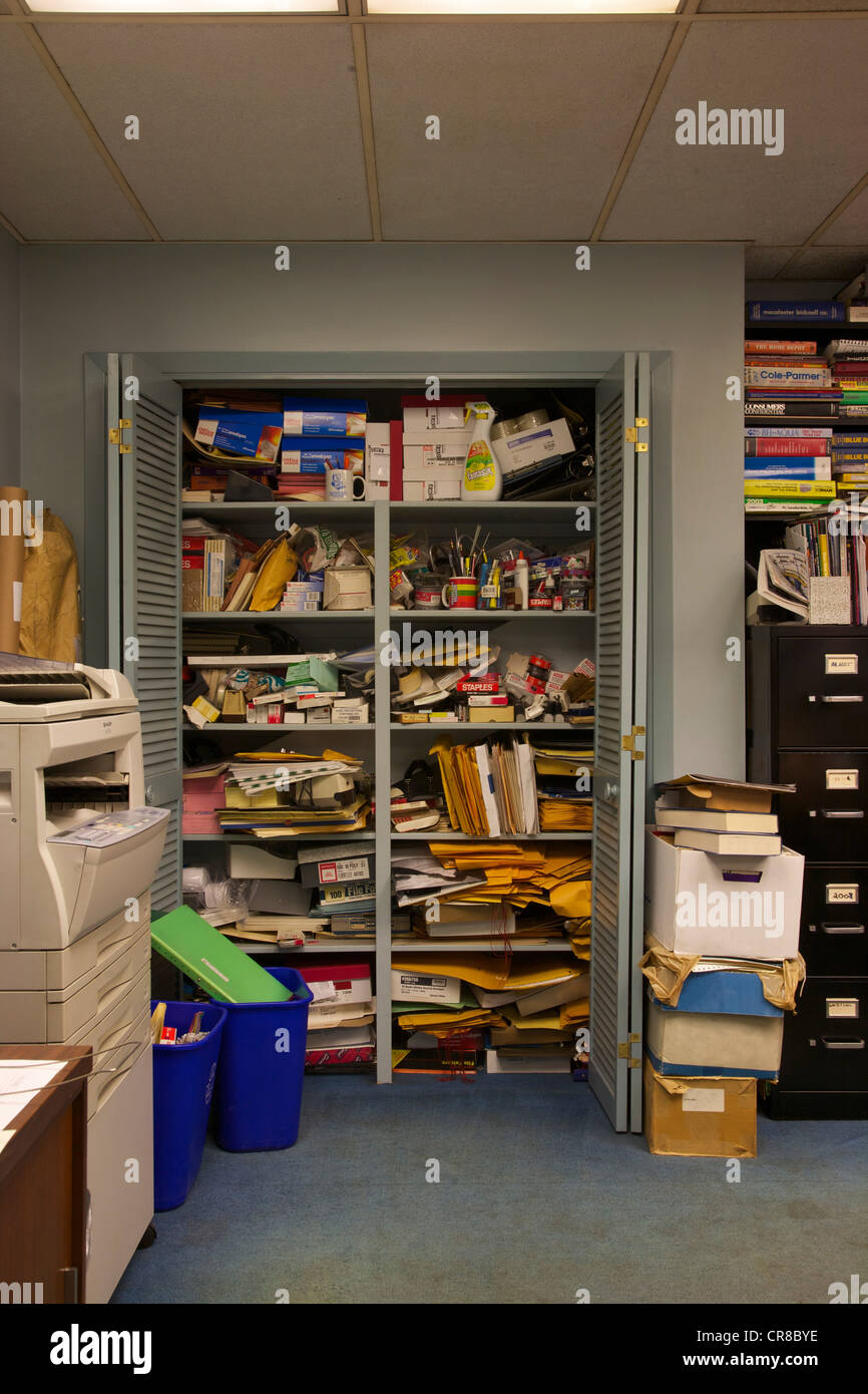 Disorganised supplies in an office - Stock Image