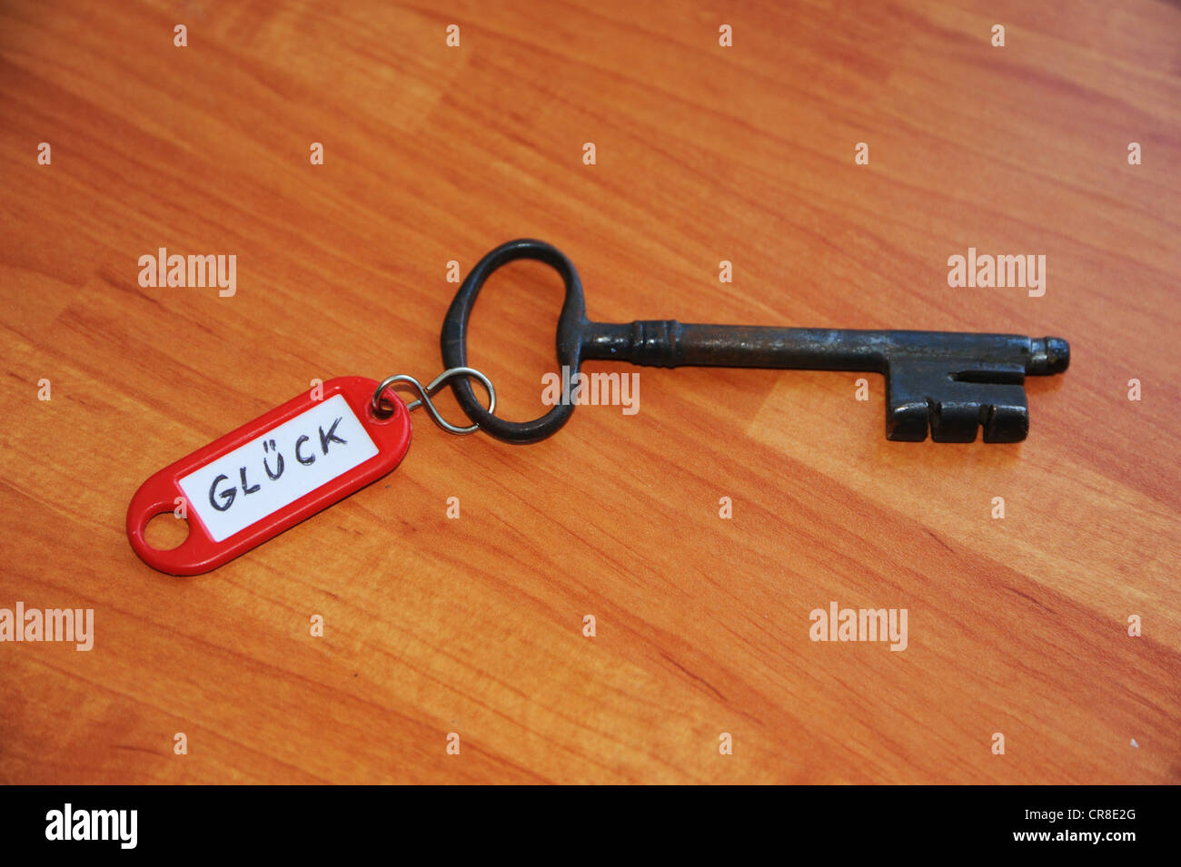 Key ring with the sign 'Glueck', German for 'luck' symbolic image for 'key to happiness' - Stock Image