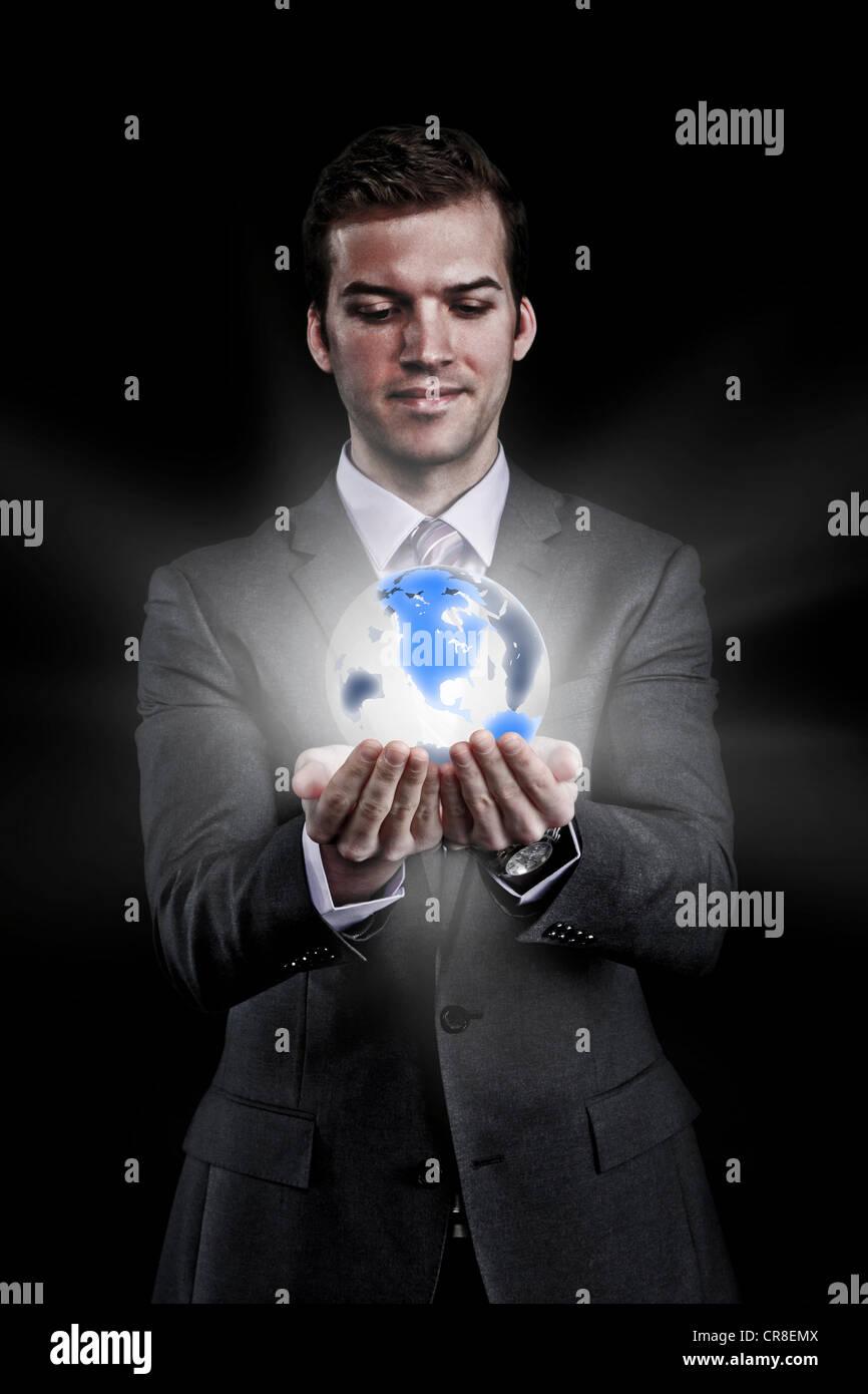 Man holding holographic globe - Stock Image