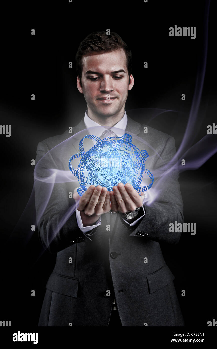 Man holding holographic information ball - Stock Image