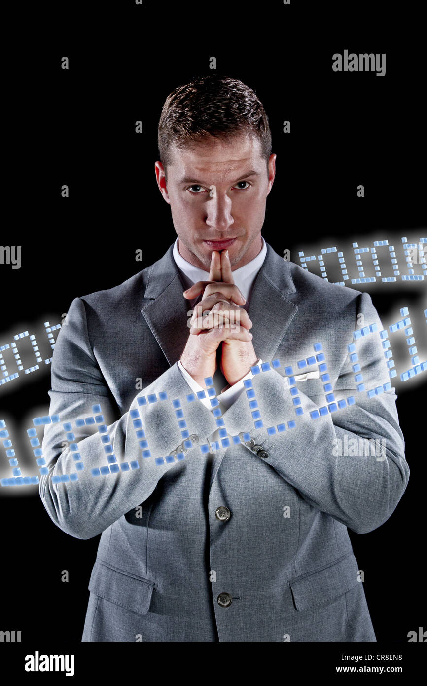 Businessman surrounded by ring of binary code - Stock Image