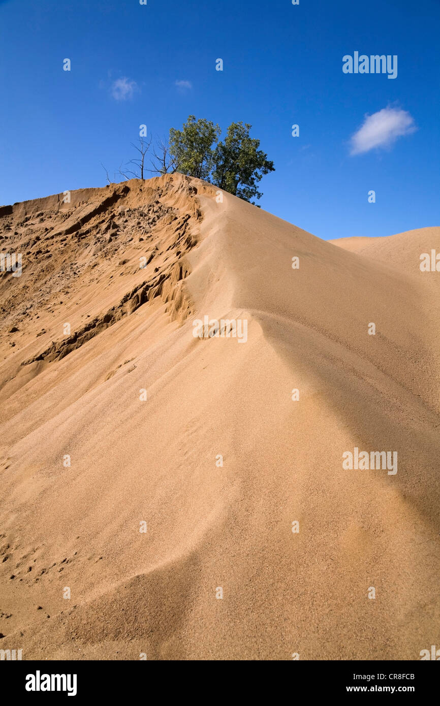 Mound of sand in commerical sand pit - Stock Image