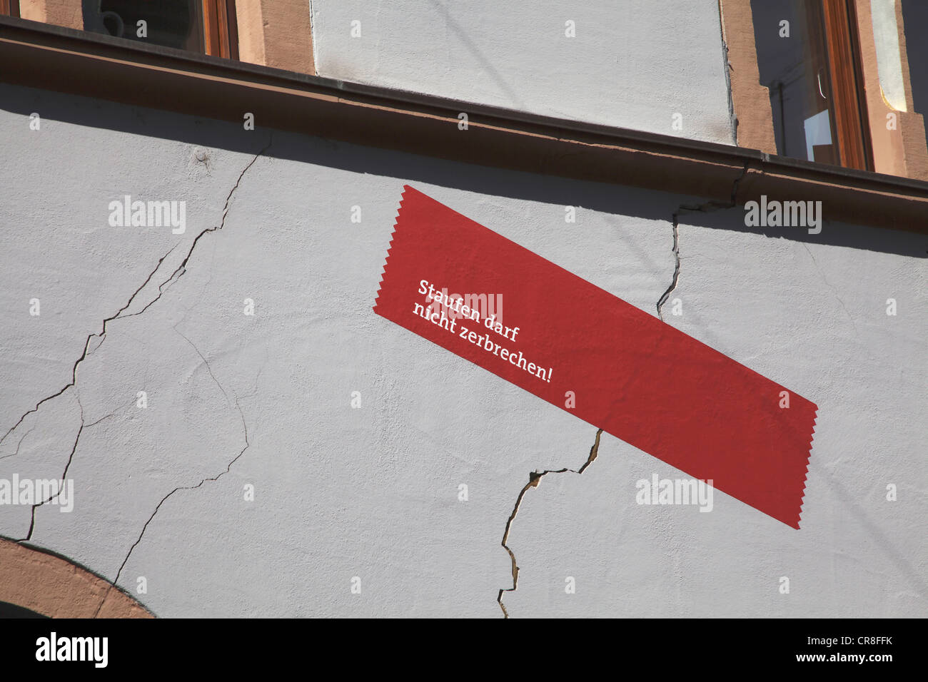 Cracks on the facade of a house caused by the elevating ground, a result of geothermal drilling in the area, historic - Stock Image