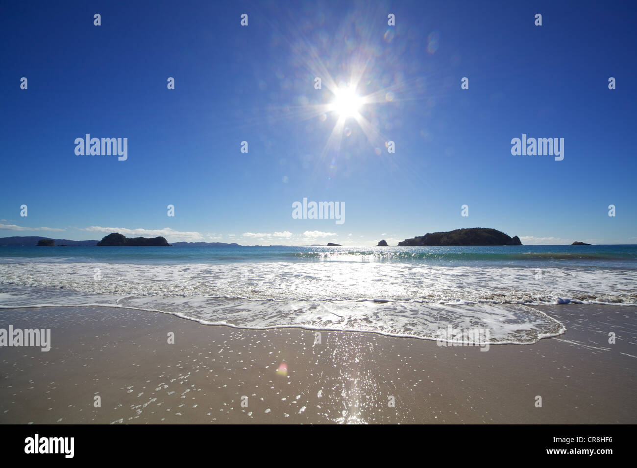 View out to sea in sunlight, Hahei, Waikato Region, New Zealand - Stock Image