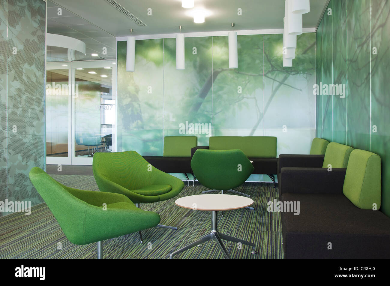 Sofas and chairs in empty office block - Stock Image