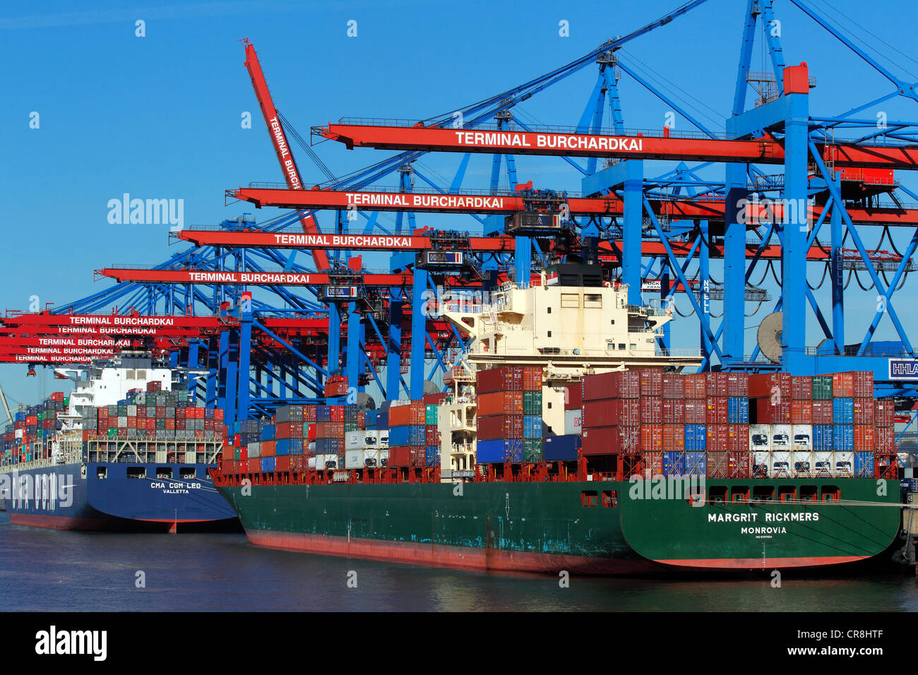 Container ships, Margrit Rickmers and CMA CGM Leo, being loaded with containers at the Container Terminal Burchardkai - Stock Image