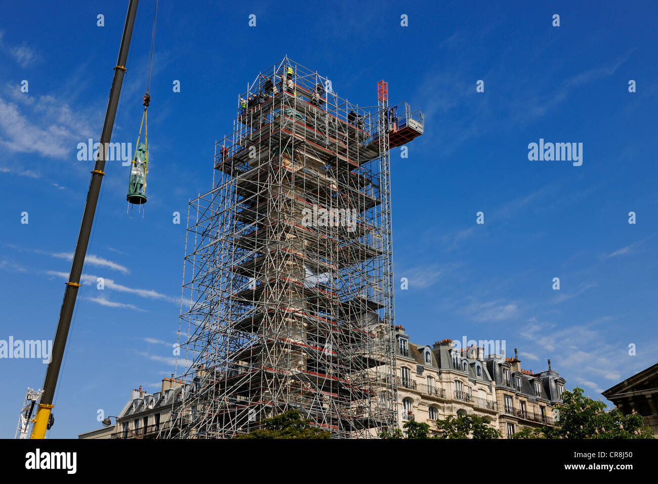 France, Paris, Place de la Nation, relocation of the statue Saint Louis on one of the two columns of the barrier - Stock Image
