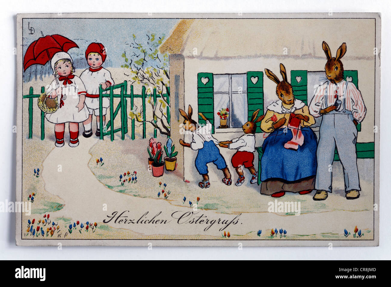 Easter greetings, children visiting an Easter bunny family, historical postcard, circa 1900 - Stock Image