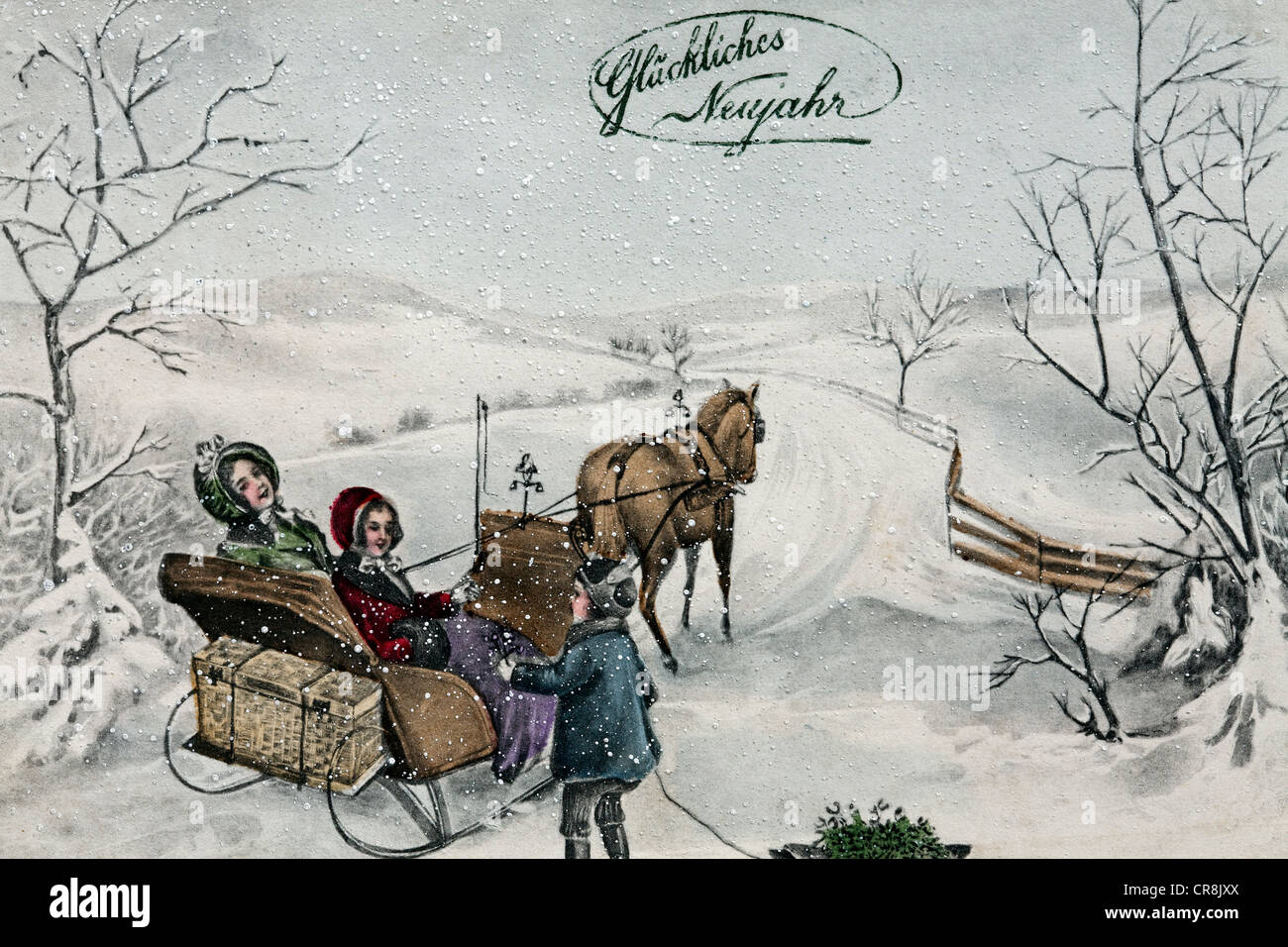 Happy New Year, children taking a sleigh ride in the snow, historical postcard, circa 1900 - Stock Image