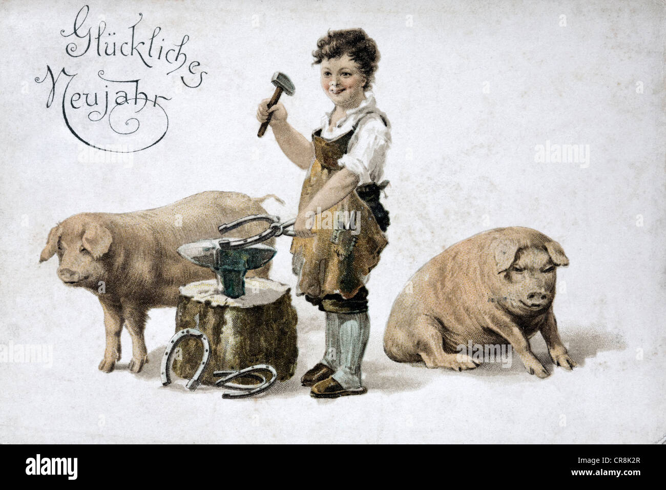 Historic New Year's card with symbols of good fortune, boy forging horseshoes next to pigs, around 1900 - Stock Image