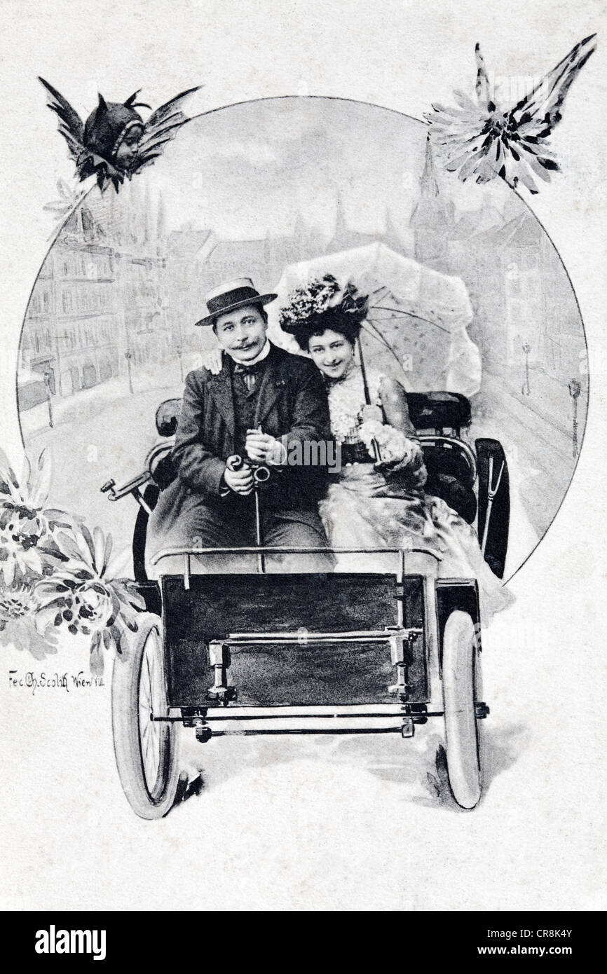 Couple in an open motor vehicle, historic postcard, around 1900 - Stock Image