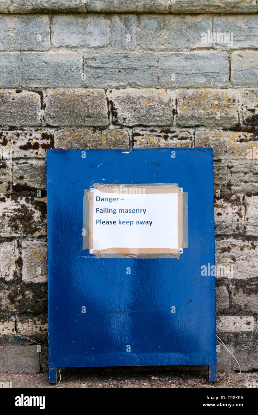 Danger Falling Masonry sign. - Stock Image