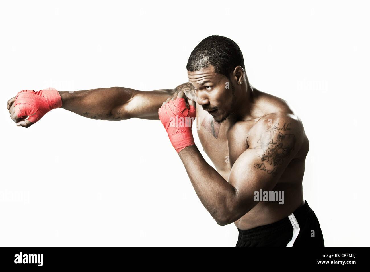 Boxer punching - Stock Image