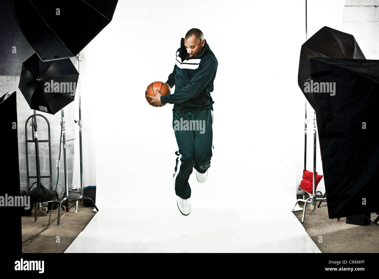 Basketball player at photo shoot - Stock Image