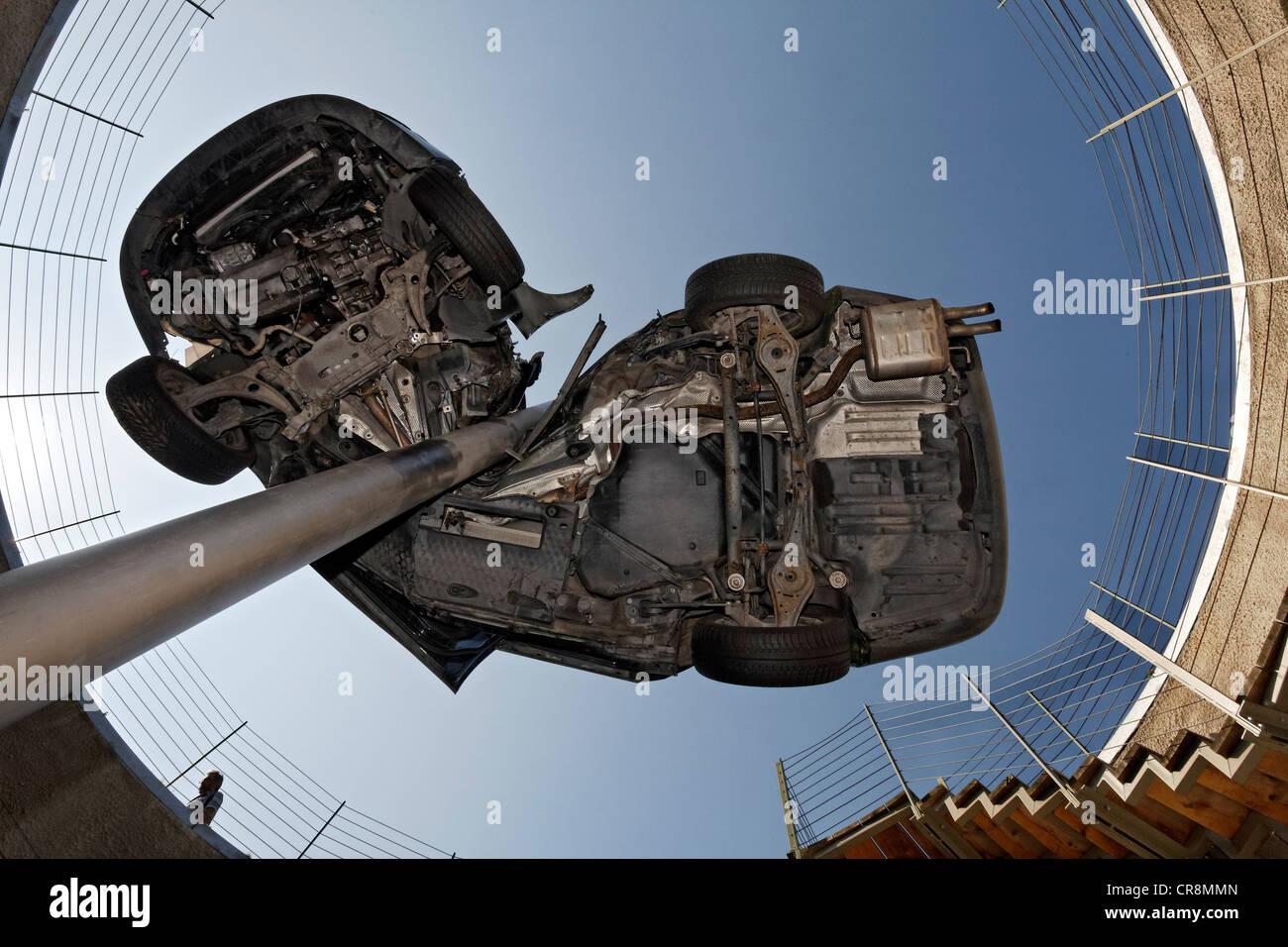Demolished totalled car, impaled, sculpture 'Reaktor' or reactor by Dirk Skreber, Skulpturenpark Koeln sculpture - Stock Image