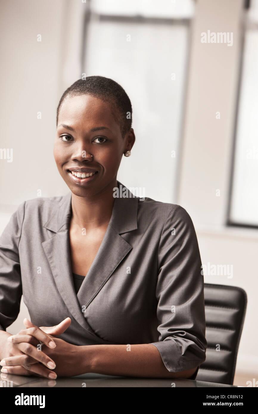 Young businesswoman at desk, portrait Stock Photo