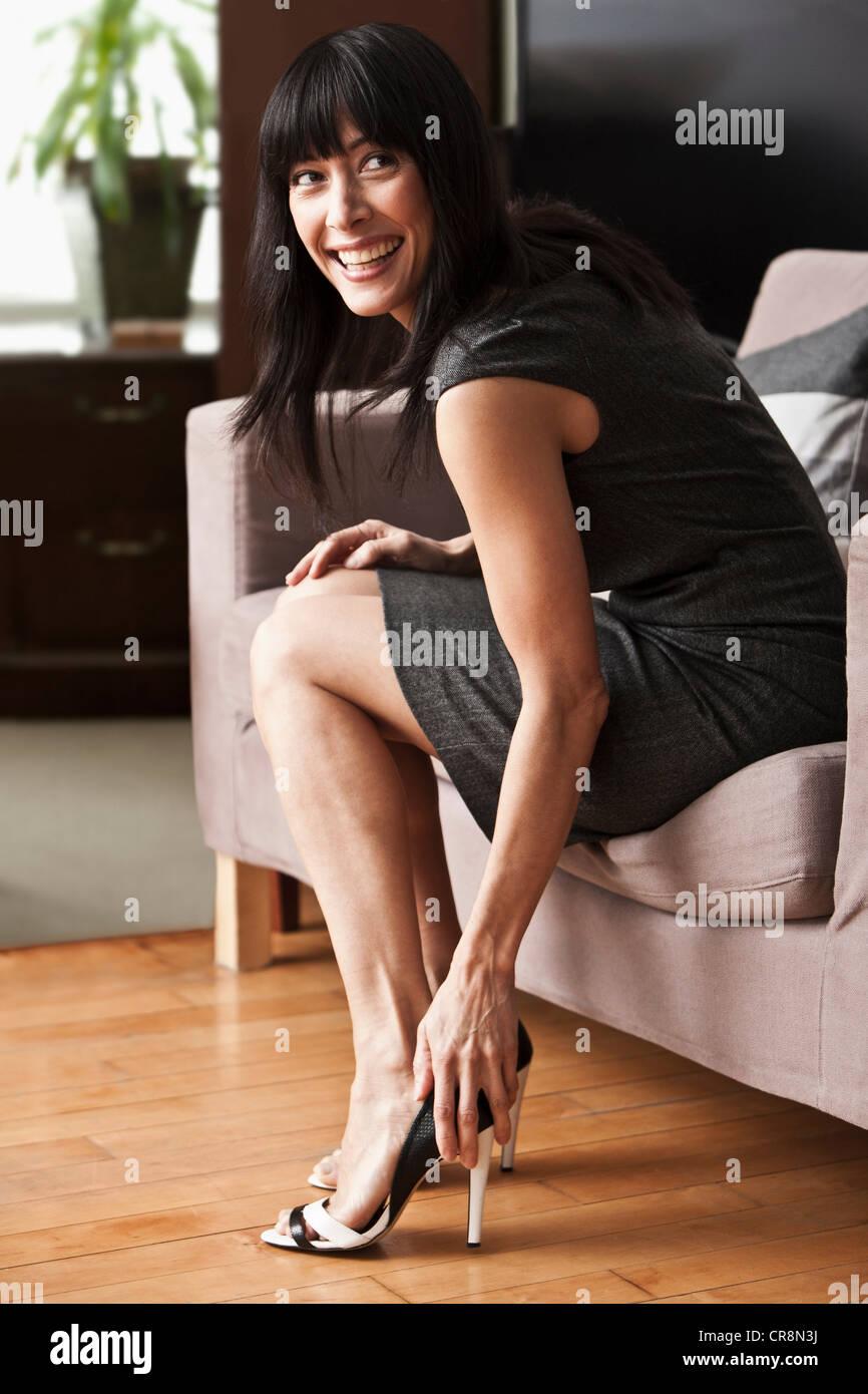 Mature Woman Putting On Stilettos Stock Photo 48750006