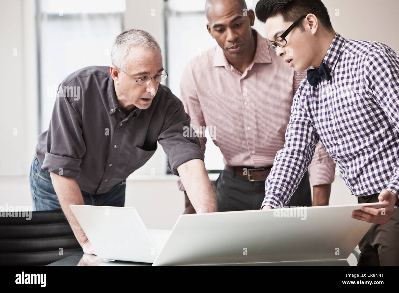 Three business people in meeting - Stock Image