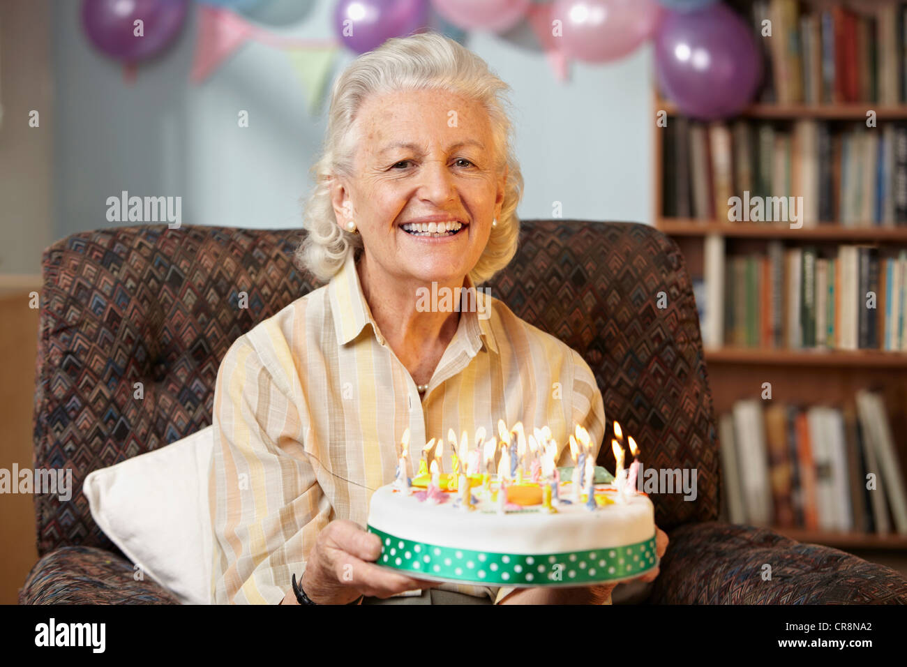 Senior Woman Holding Birthday Cake Portrait