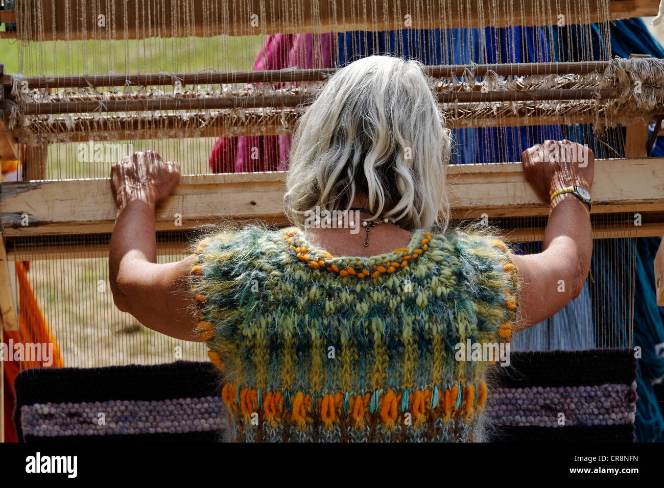 Woman working on a wooden hand loom, Flachsmarkt historical crafts market, Krefeld-Linn, North Rhine-Westphalia, - Stock Image
