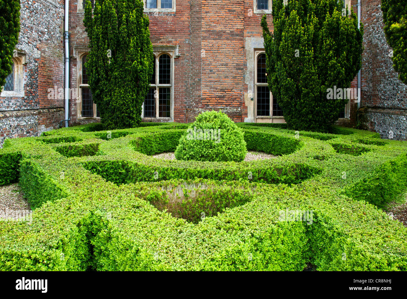 A knot garden of low box hedging the English country garden of Littlecote Manor in Berkshire, England, UK - Stock Image