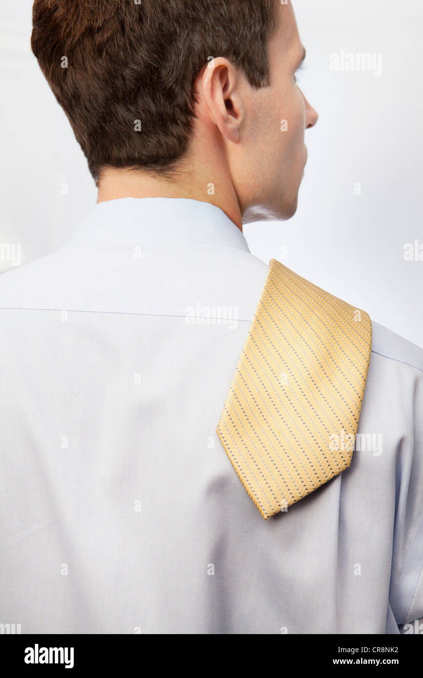 Young man with tie over shoulder Stock Photo