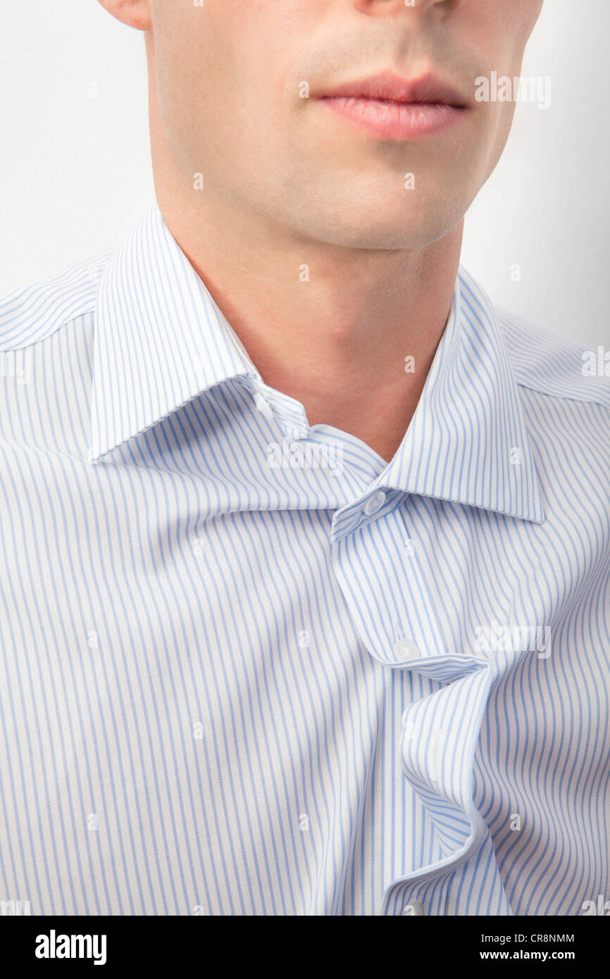 Young man with messy shirt - Stock Image
