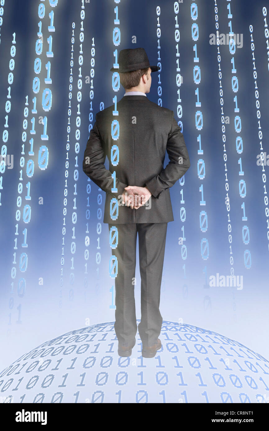 Businessman standing on binary globe with binary strings - Stock Image
