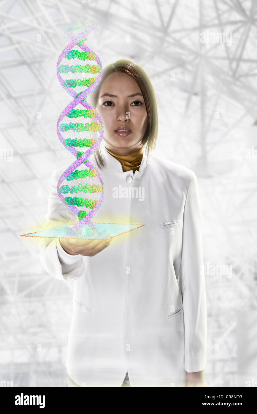 Female scientist with holographic genome - Stock Image