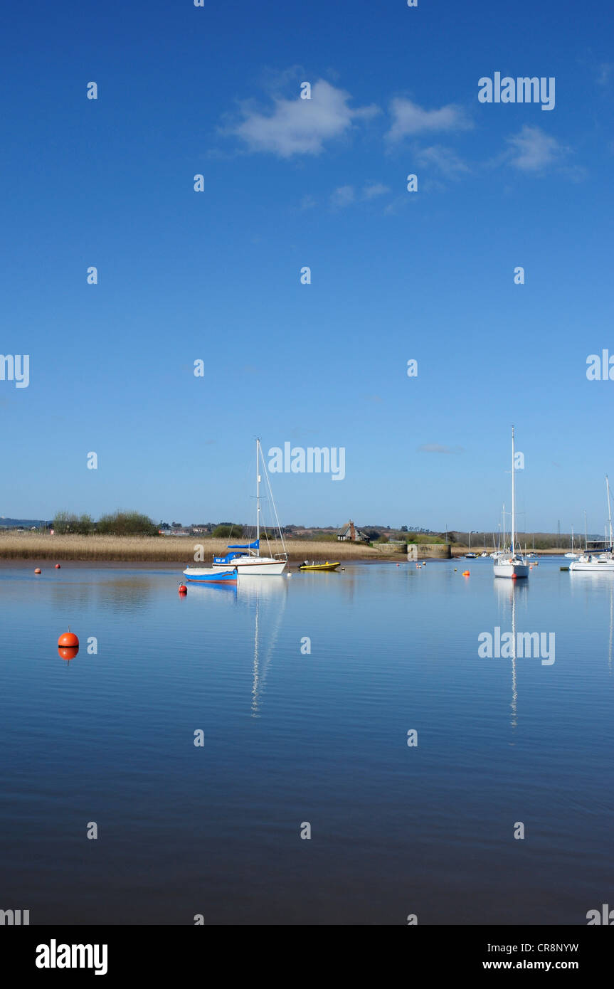 Boats and reflections on the River Exe, Topsham, Devon, England, UK - Stock Image