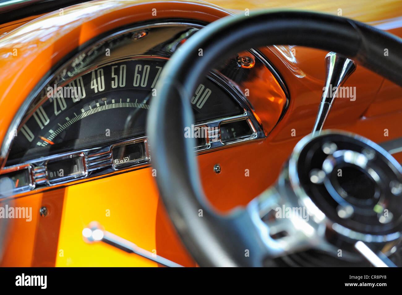 Closeup on odomoeter on orange seventies American car - Stock Image