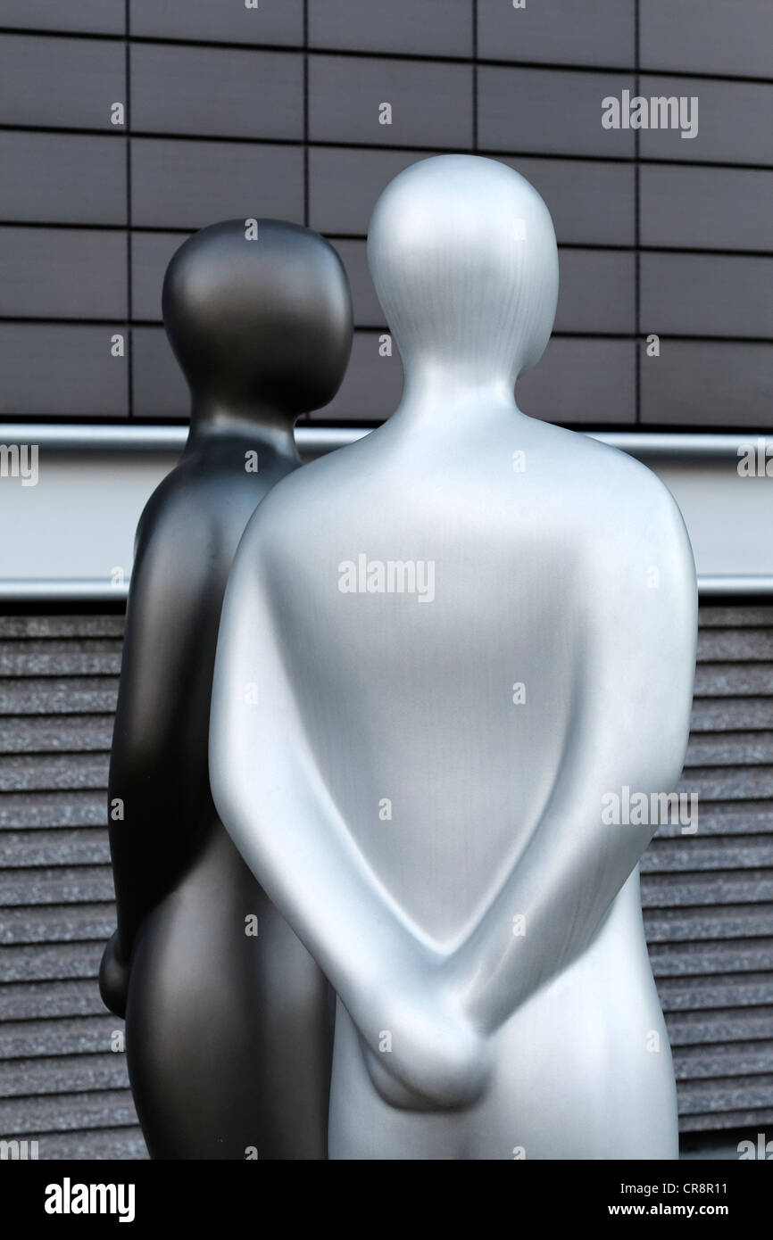 Two manlike sculptures standing side by side, without any individual characteristics, anonymous, modern sculptures - Stock Image