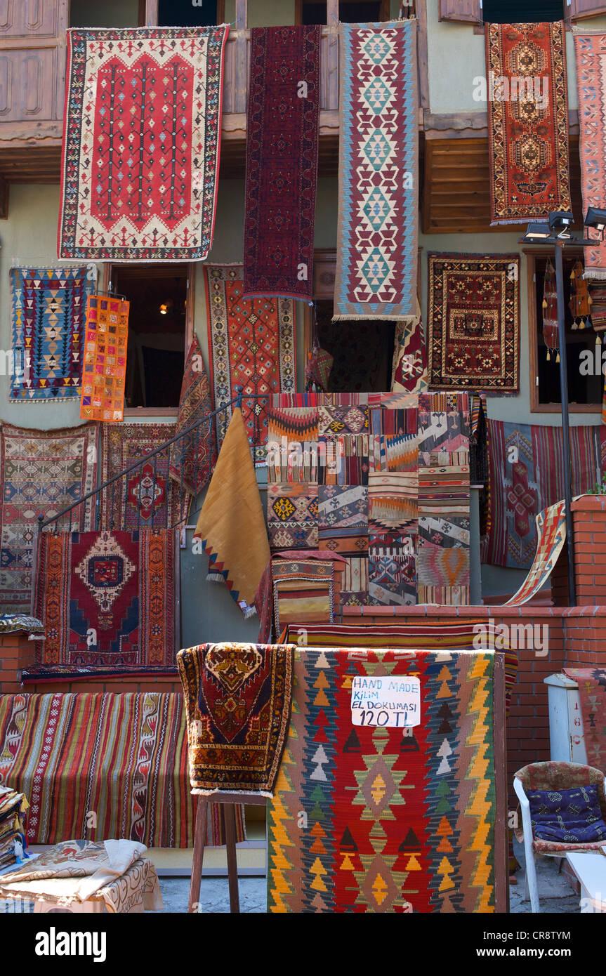 Carpets on the bazaar in Fethiye, Turkish Aegean Coast, Turkey - Stock Image