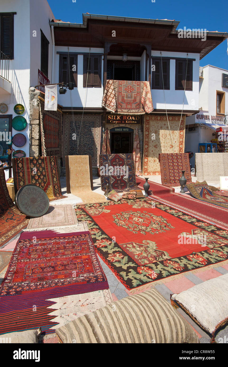 Rugs for sale at the waterfront of Marmaris, Turkish Aegean Coast, Turkey - Stock Image