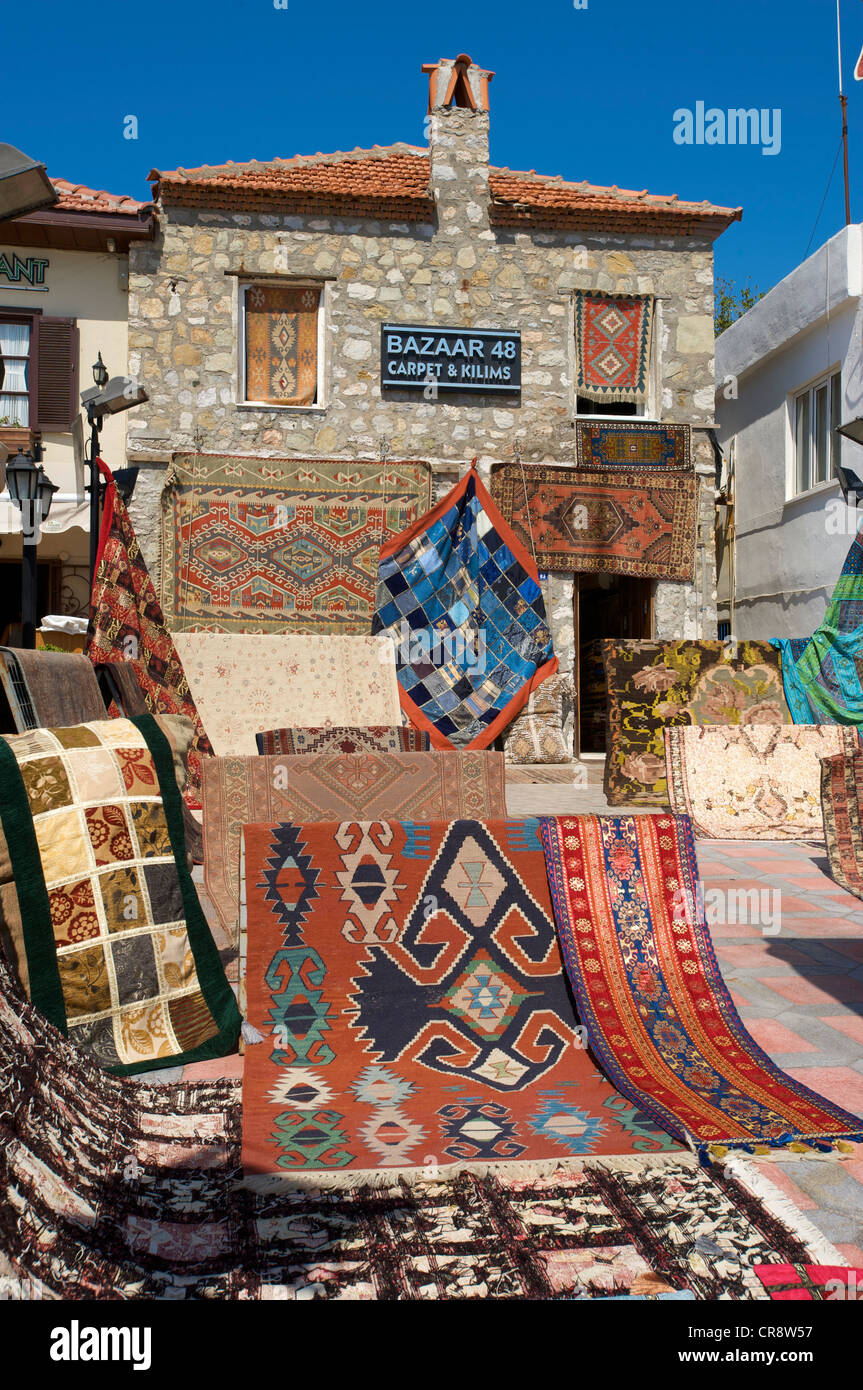 Rugs for sale at the waterfront in Marmaris, Turkish Aegean Coast, Turkey - Stock Image